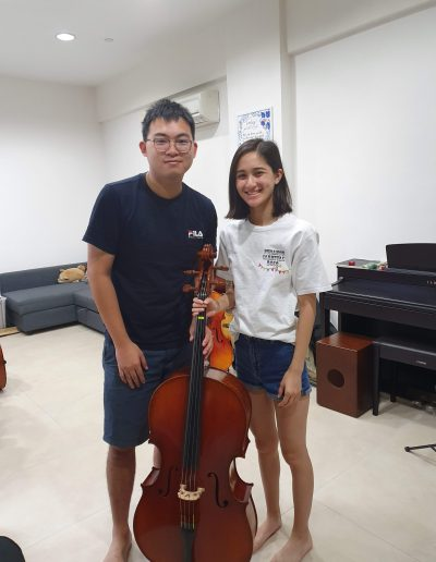 happy customer with her cello rental