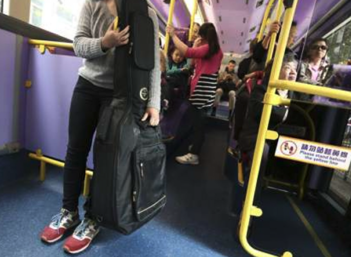 Girl Carrying cello on the bus