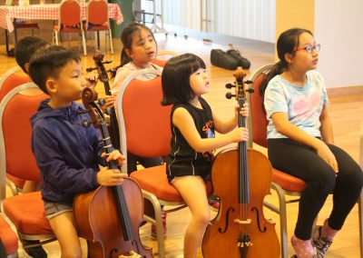 Kids listening to singapore cello teacher