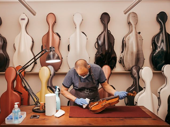 Strings Luthier repairing violin and cello in Singapore