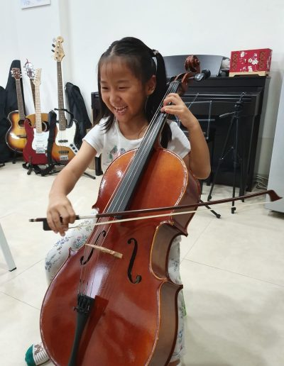 happy kids love to play cello